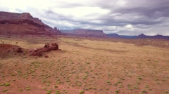 Aerial shot of stormy desert buttes near Moab Stock Footage