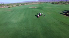 4K Aerial Drone Desert Golf Course Flyover Carts and Golfers on Fairway Stock Footage
