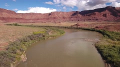 Aerial travelling shot of a buttes and river near Moab Utah Stock Footage