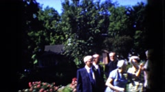 1969: merry making old people gather in a place with rich greenery CALIFORNIA Stock Footage
