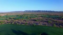 4K Aerial Drone Desert Golf Course Pull Back Over Fairways Stock Footage