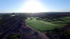 4K Aerial Drone Desert Golf Course Cars Arriving at Sunrise by Fairway Stock Footage