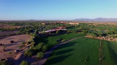 4K Aerial Drone Desert Golf Course Pull Back and Tilt Down Over Driving Range Stock Footage