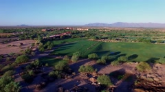 4K Aerial Drone Desert Golf Course Flyover Golfers on Driving Range at Sunrise Stock Footage