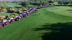 4K Aerial Drone Desert Golf Course Crane Down Carts Waiting for Tournament Stock Footage