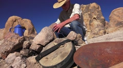 Cowboy sitting at the fire pit, high angle Stock Footage