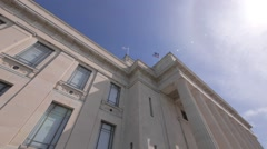 Looking up at flags at a Museum Building Stock Footage