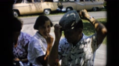 1957: people on beach sandwich maker putting ketchup hat car parked green grass Stock Footage