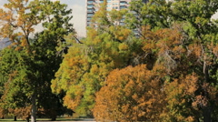 View of the apartment building through the park. Stock Footage