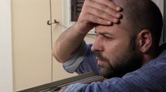 Worried man at the window, his girlfriend does not come Stock Footage