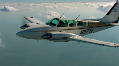 Beechcraft Baron Air to Air Straight to a Turn Stock Footage
