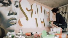 4K Talented young graffiti street artist working on a mural in urban area Stock Footage