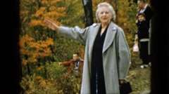 1957: lady addressing and describing the natural beauty in the nature in coat Stock Footage