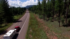 4K Aerial Tilt Up Reveal Mountain Forest Road Trip Stock Footage