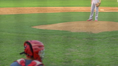 A batter at a baseball game prepares to swing the bat and hit the ball. Stock Footage