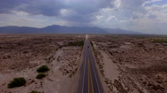 4K Aerial Fly Over Cars and Trucks Desert Highway Rays of Light Mountain Stock Footage
