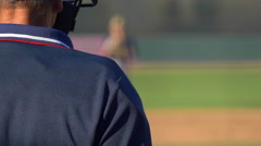 The umpire at a baseball game makes a call, slow motion. Stock Footage