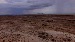 4K Aerial Fly Forward Desolate Desert Rain Sand Storm Mountain Stock Footage