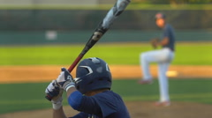 The batter bunts the ball at a baseball game, slow motion. Stock Footage