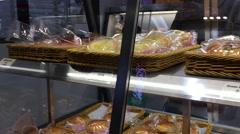 Motion of foods on display rack inside Saint Germain bakery Stock Footage