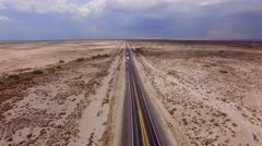 4K Aerial Reveal Arizona Highway Cars Dramatic Clouds Stock Footage