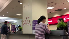 People talking to the teller inside Scotiabank Stock Footage