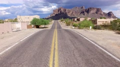 4K Aerial Fly Over Mining Camp Road Reveal Superstition Mountains Stock Footage