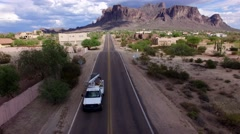 4K Aerial Tilt Up Superstition Mountains White Work Truck Stock Footage