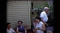 1969: older couples chat in back yard CALIFORNIA Stock Footage