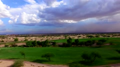 4K Aerial Drone Desert Golf Course Sideways View of Dust Storm Behind Fairway Stock Footage