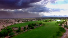 4K Aerial Drone Desert Golf Course Sandstorm Approaches Fairway Stock Footage