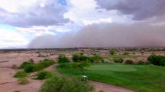 4K Aerial Drone Desert Golf Course Pan of Dust Storm Approaching Fairway Stock Footage