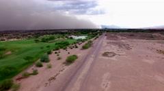 4K Aerial Drone Desert Golf Course Fly Forward Dust Storm and Fairway Stock Footage