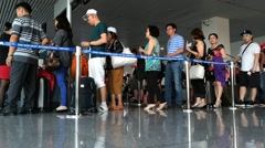Air passengers check in before boarding the plane to Ho Chi Minh City Stock Footage