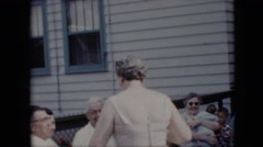 1969: family members acting silly together out in the yard. CALIFORNIA Stock Footage