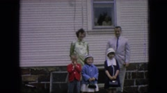 1964: a family posing outside in front of the house PHILADELPHIA PENNSYLVANIA Stock Footage