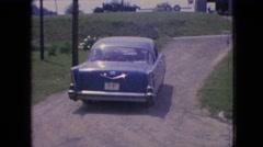 1964: vehicle leaving the driveway. PHILADELPHIA PENNSYLVANIA Stock Footage