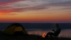 4K.  Man  waiting sunrise with coffee or tea near lake.   Stock Footage