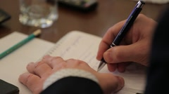 Hand journalist who writes in a notebook information. Stock Footage
