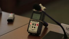 A device to record sound. The journalist writes a speech speaker. Stock Footage