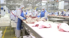 People prepare fresh meat for delivery to stores. Stock Footage
