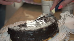 Female hand cut a piece of cake, close-up Stock Footage