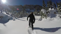A young man snowshoeing in the mountains, super slow motion. Stock Footage