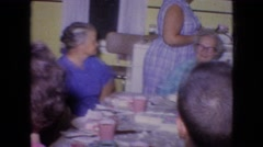 1964: family gathering having tea time excited Stock Footage