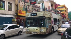 Tourists in a citysightseeing tourist bus with panoramic roof Stock Footage