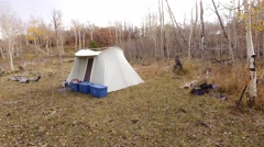 Aerial ascending shot of hunting camp in the mountain Stock Footage