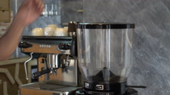 The coffee latte art, coffee beans put into a coffee grinder. Stock Footage