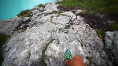 POV of a man hiking on a trail in the mountains near lake Lago di Sorapiss in It Stock Footage