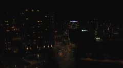 Rising aerial view of Birmingham city centre, UK at night. Arkistovideo