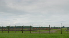 4K Auschwitz Birkenau, Field of Former Male Prison Barracks Buildings, Barb Wire Stock Footage